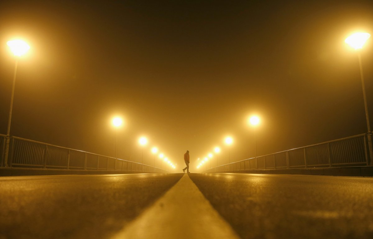 a-man-walks-on-the-street-during-heavy-smog-in-the-central-bosnian-town-of-zenica-early-november-19-2014